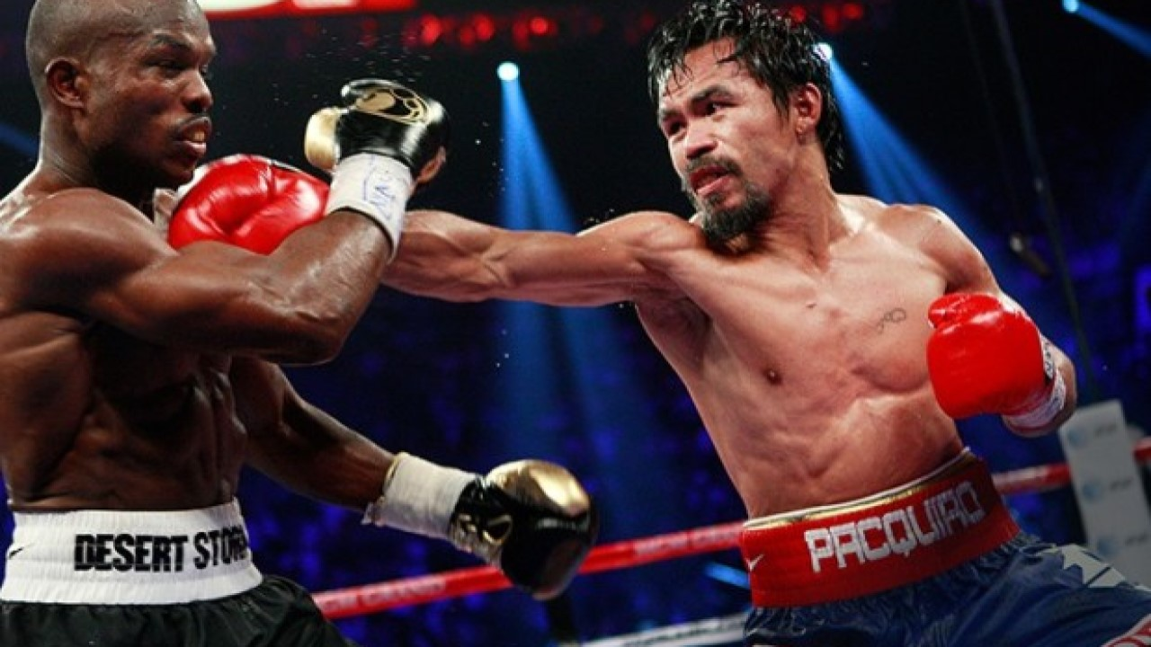 Pacquiao hits Bradley with a straight right hand.